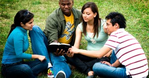 Students gathering around to study the bible